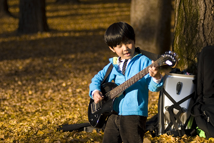 yoyogi park autumn boy guitar